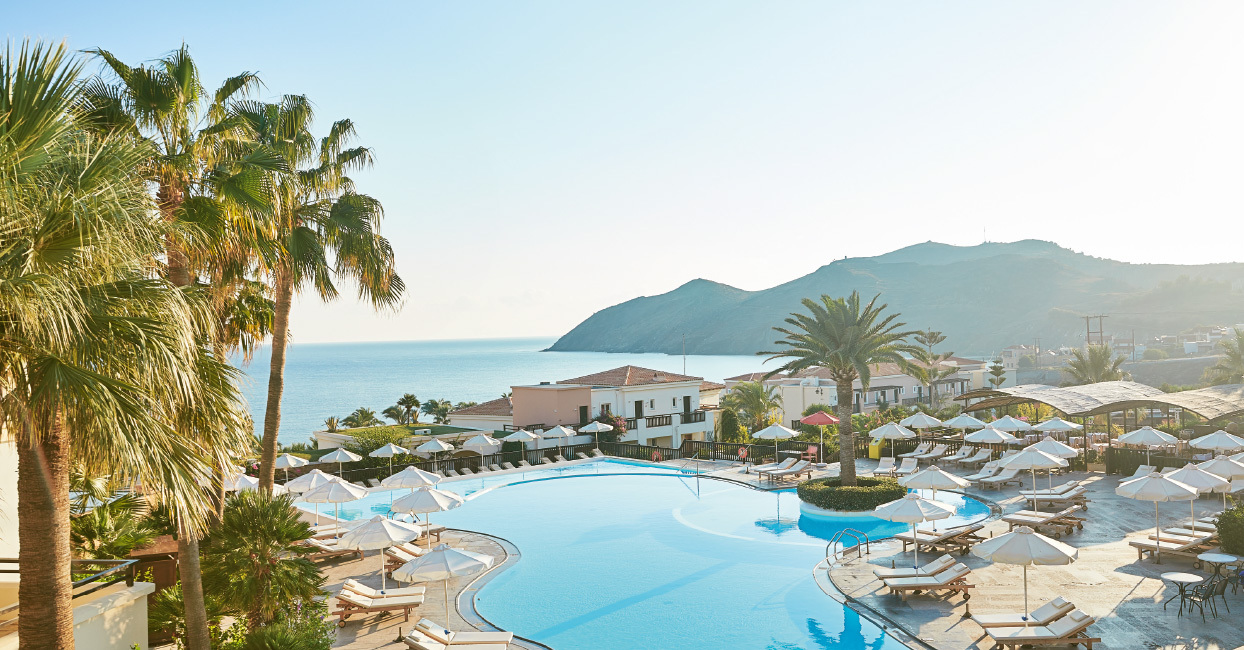 03-beach-and-pools-in-grecotel-marine-palace-resort